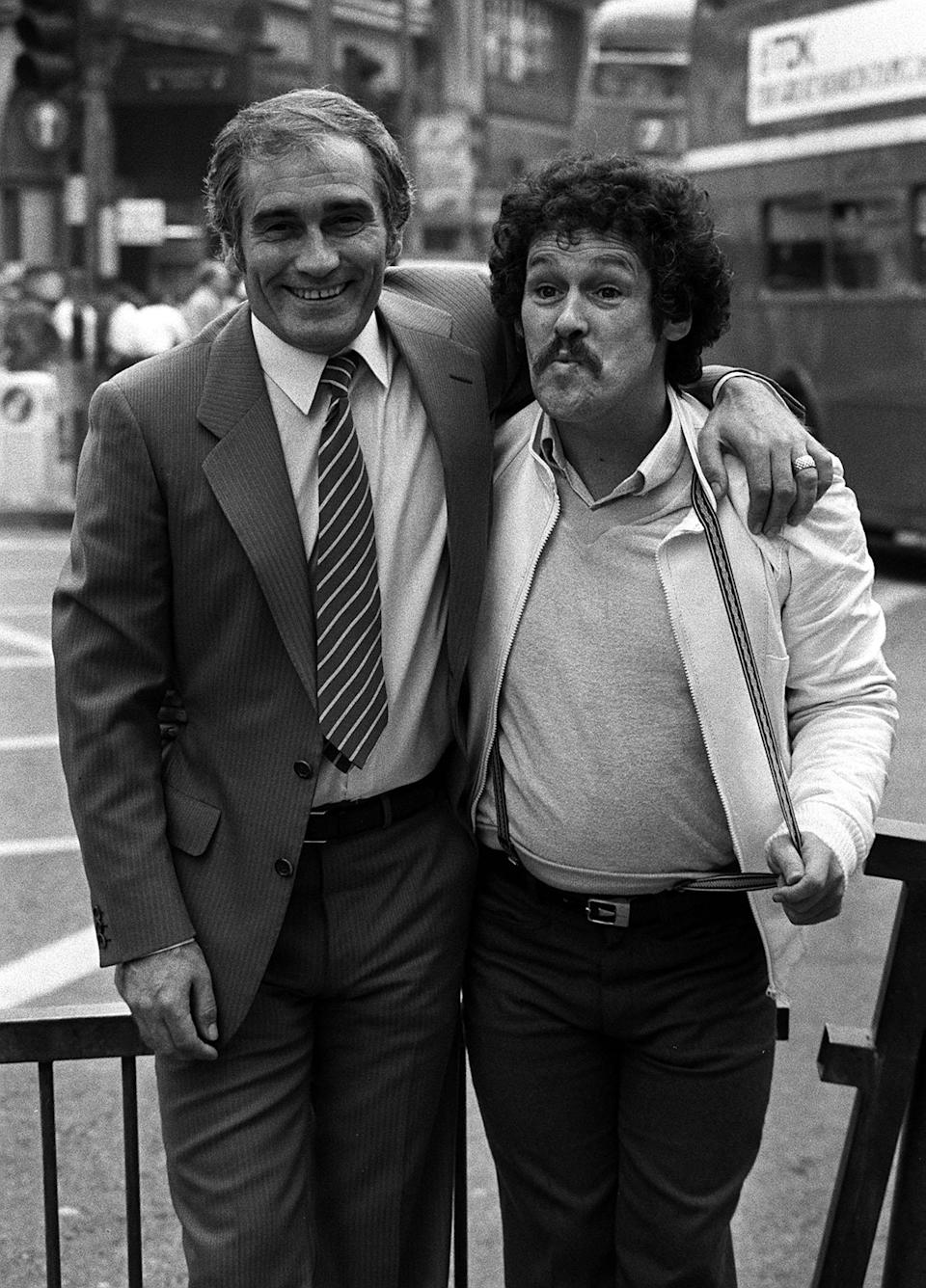 """File photo dated 17/05/82 of comedians Tommy Cannon (left) and Bobby Ball preparing for their first film """"Boys In Blue"""", outside the Dominion Theatre, London. Bobby Ball, one half of the comedy double act Cannon and Ball, has died at the age of 76 after testing positive for Covid-19, his manager has said."""