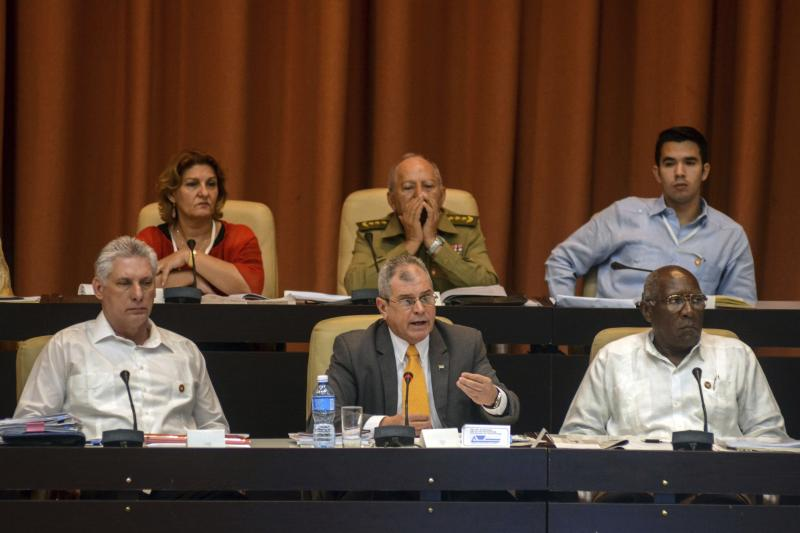Cuban President Miguel Diaz-Canel, from left, Secretary, Council of State Homero Acosta Alvarez and First Vice President, Council of State Salvador Valdes Mesa, attend a National Assembly session in Havana, Cuba, Saturday, July 21, 2018. Cuban lawmakers approved the Cabinet named by Diaz-Canel, keeping most of the ministers from Raul Castro's government in place. (Abel Padron/Agencia Cubana de Noticias via AP)