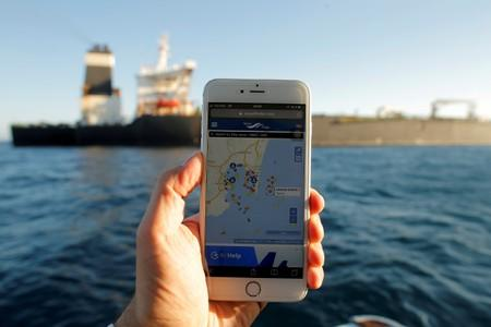 FILE PHOTO: The position of the Iranian oil tanker Adrian Darya 1, formerly named Grace 1, is seen on a mobile phone as it sits anchored after the Supreme Court of the British territory lifted its detention order, in the Strait of Gibraltar