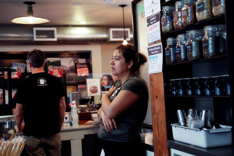 FILE PHOTO: Alcira Perez, a dish washer of nine years at Farley's East cafe that closed due to the financial crisis caused by the coronavirus disease (COVID-19), stands during an employee meeting at the cafe in Oakland