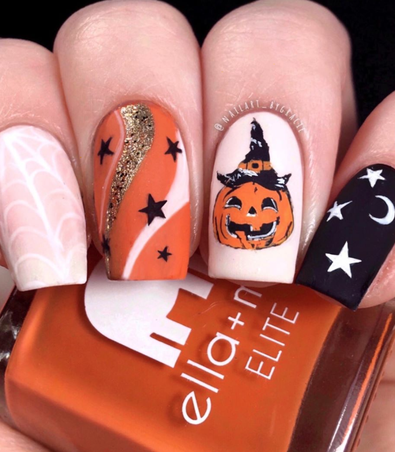 """<p><a href=""""https://www.instagram.com/p/B4L7oSoBLbq/"""" rel=""""nofollow noopener"""" target=""""_blank"""" data-ylk=""""slk:Freehand nail artist Gracie"""" class=""""link rapid-noclick-resp"""">Freehand nail artist Gracie</a> creates this swirly orange-and-pink inspired look, with a big pumpkin accent nail to solidify the Halloween theme. </p><p><a class=""""link rapid-noclick-resp"""" href=""""https://go.redirectingat.com?id=74968X1596630&url=https%3A%2F%2Fwww.etsy.com%2Flisting%2F630031842%2Fnail-art-water-decals-stickers-transfers&sref=https%3A%2F%2Fwww.oprahmag.com%2Fbeauty%2Fskin-makeup%2Fg33239588%2Fhalloween-nail-ideas%2F"""" rel=""""nofollow noopener"""" target=""""_blank"""" data-ylk=""""slk:SHOP PUMPKIN NAIL DECAL"""">SHOP PUMPKIN NAIL DECAL</a></p>"""