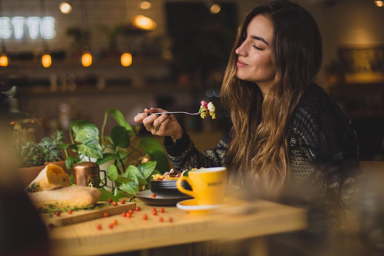 """<p>The truth is, when you change what you eat, drastic calorie cutting isn't even necessary in order to transform how you look and feel. One <a href=""""https://www.ncbi.nlm.nih.gov/pmc/articles/PMC2897733/"""">study</a> found that switching from processed foods to whole foods can result in burning 50% more post-meal calories. Other research shows that consuming more <a href=""""https://www.ncbi.nlm.nih.gov/pubmed/19158230?ordinalpos=1&itool=EntrezSystem2.PEntrez.Pubmed.Pubmed_ResultsPanel.Pubmed_DefaultReportPanel.Pubmed_RVDocSum"""">fiber</a>, <a href=""""https://news.ufl.edu/archive/2009/10/phytochemicals-in-plant-based-foods-could-help-battle-obesity-disease.html"""">antioxidants</a>, and <a href=""""https://www.health.com/type-2-diabetes/pulses-beans-legumes-diabetes"""">pulses</a> (including beans, lentils, peas, and chickpeas), is tied to leanness and a smaller <a href=""""https://www.ncbi.nlm.nih.gov/pubmed/22916807"""">waist</a> measurement, even without cutting calories.</p> <p>In our diet meal plan, each breakfast, lunch, and dinner is either vegan or has a vegan option, and is gluten-free and dairy-free. And every meal is chock-full of flavor, in addition to anti-inflammatory, immune-supporting ingredients.</p> <p>So, out with unsatisfying diet food–and in with nutrient-rich, naturally filling whole foods. And a daily dark chocolate treat to boot!</p> <p><strong>RELATED: <a href=""""https://www.health.com/weight-loss/intermittent-fasting-metabolism-study"""">A Super-Early Dinner Can Burn More Fat, Study Finds</a></strong></p>"""