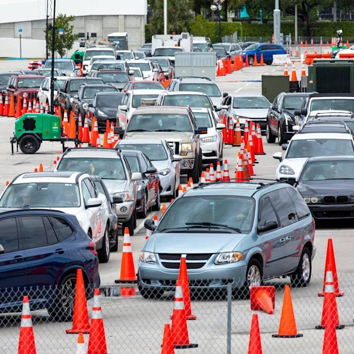 People line up inside their cars to get vaccinated at Hard Rock Stadium in Miami Gardens, Florida, on Monday, April 12, 2021. The site will no longer require appointments and have expanded COVID vaccine hours.