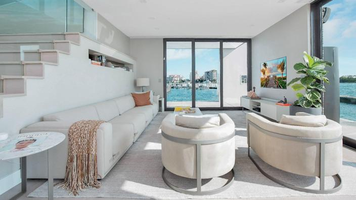 A similarly sleek lounge area inside the home offers great views of the surrounding seas.