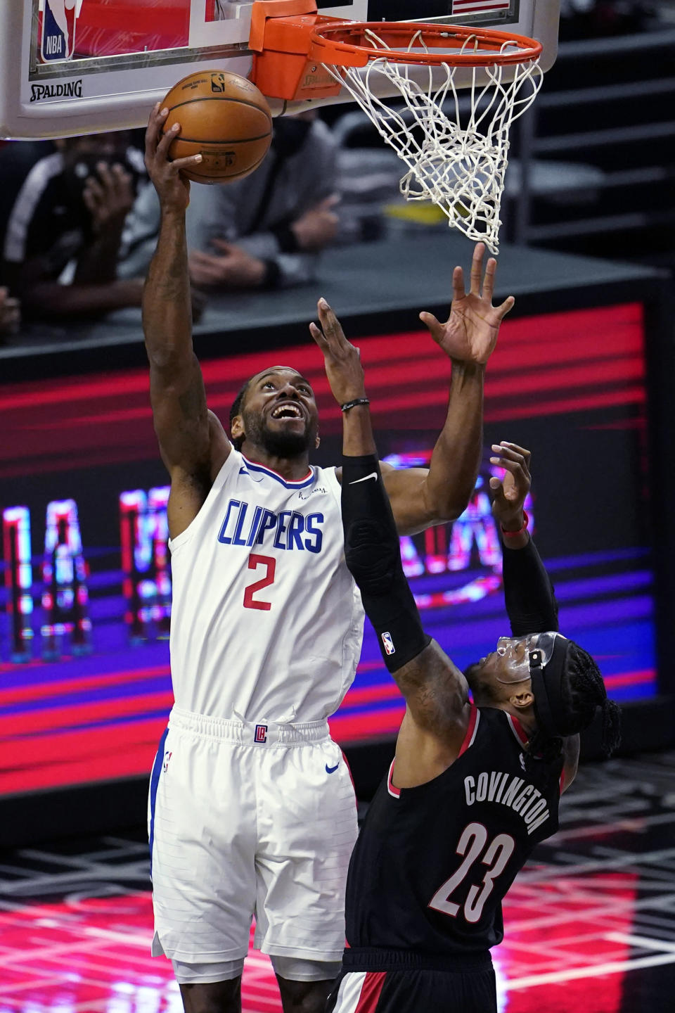 Los Angeles Clippers forward Kawhi Leonard (2) scores over Portland Trail Blazers forward Robert Covington (23) during the first half of an NBA basketball game Tuesday, April 6, 2021, in Los Angeles. (AP Photo/Marcio Jose Sanchez)