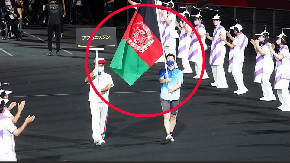 The flag of Afghanistan, pictured here being carried by volunteers at the Paralympics opening ceremony.