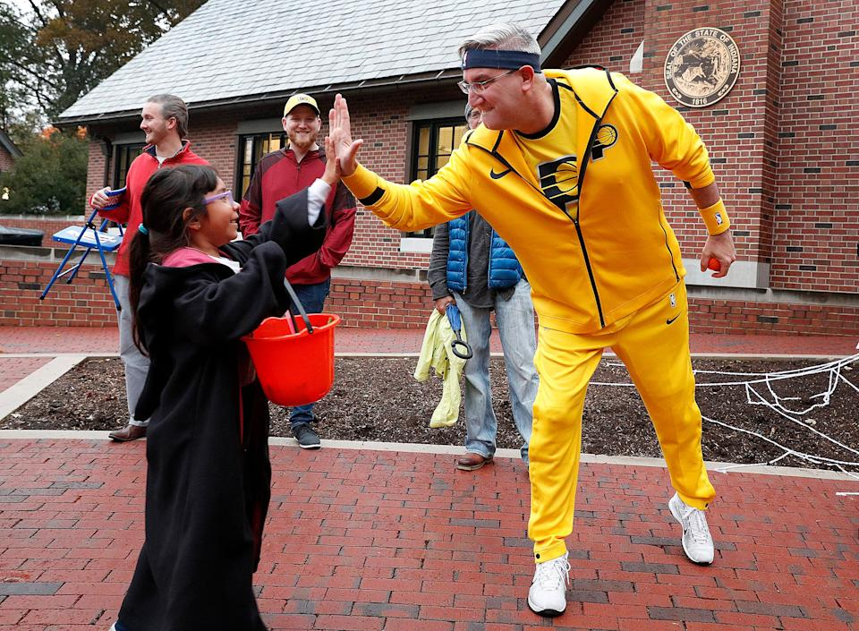 Gov. Eric J. Holcomb greets Sarah Carrasco as trick-or-treaters gather at the Governor's Residence in Indianapolis to celebrate Halloween on Oct. 31, 2018.