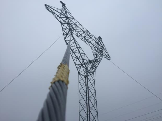 A guy-wired-supported steel transmission tower like this one collapsed June 19, 2017, near Come by Chance, resulting in the death of two linemen.