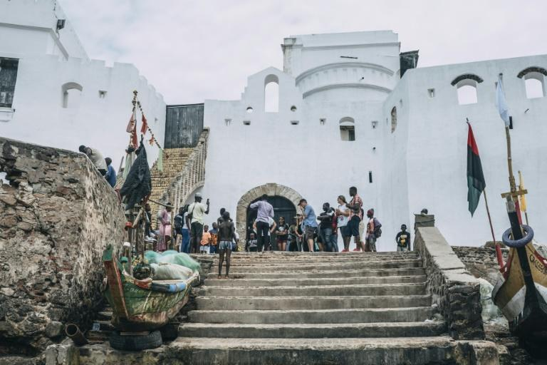 Tourists visit the 'Door of No Reutrn' at Cape Coast Castle in Ghana where enslaved Africans were loaded onto ships to the Americas (AFP Photo/NATALIJA GORMALOVA)