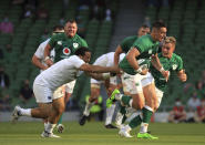 Ireland's James Hume, right, is tackled by USA's Christian Dyer , during the Rugby Union International Summer Series match between Ireland and USA, in Dublin, Ireland, Saturday July 10, 2021. (Donall Farmer/PA via AP)