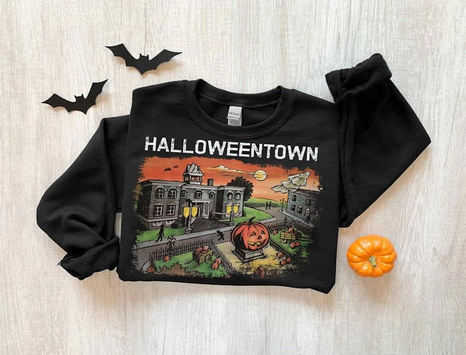 """<p>If you love the classic Halloweentown movies, you'll adore this <span>Halloweentown Crewneck Sweatshirt</span> ($10, and up). It's the cutest way to rock your love for all things <a class=""""link rapid-noclick-resp"""" href=""""https://www.popsugar.com/Halloween"""" rel=""""nofollow noopener"""" target=""""_blank"""" data-ylk=""""slk:Halloween"""">Halloween</a>. </p>"""