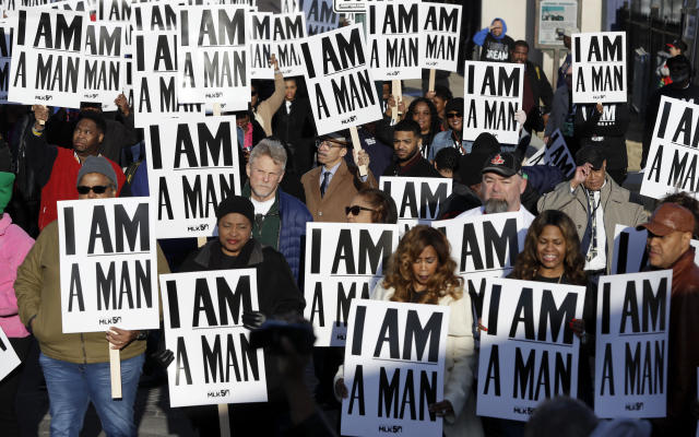 <p>People hold signs, resembling the signs carried by striking sanitation workers in 1968, as they join in events commemorating the 50th anniversary of the assassination of the Rev. Martin Luther King Jr. on Wednesday, April 4, 2018, in Memphis, Tenn. (Photo: Mark Humphrey/AP) </p>