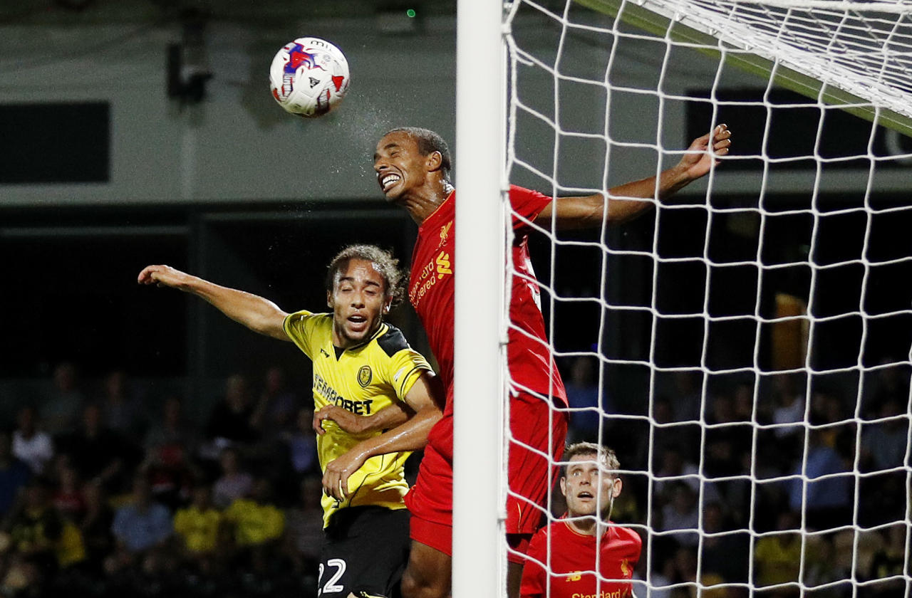 """Football Soccer Britain - Burton Albion v Liverpool - EFL Cup Second Round - Pirelli Stadium - 23/8/16 Liverpool's Joel Matip in action with Burton Albion's Marcus Harness  Reuters / Darren Staples Livepic EDITORIAL USE ONLY. No use with unauthorized audio, video, data, fixture lists, club/league logos or """"live"""" services. Online in-match use limited to 45 images, no video emulation. No use in betting, games or single club/league/player publications.  Please contact your account representative for further details."""