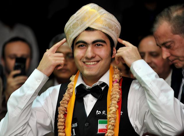 Iran's Hossein Vafaei Ayouri gestures while wearing the traditional 'Mysooru Peta' (Mysore Turban) after winning the IBSF World Snooker Championship in Bangalore on December 03, 2011. Hossein Lee Walker of Wales by 10 frames to nine. AFP PHOTO/Manjunath KIRAN (Photo credit should read Manjunath Kiran/AFP/Getty Images)