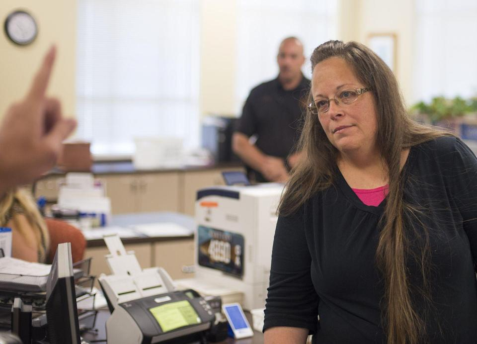 """<p>Kim Davis, a former county clerk in Kentucky, garners national attention when she refused to issue a marriage license to Robbie Blankenship and Jesse Cruz on the grounds of religious objection. Davis was sued by the couples she denied rightful marriage licenses to, and in 2017 a court ruled that the state of Kentucky would be responsible for the legal fees of the plaintiffs, a total of $224,000 <a href=""""https://www.usatoday.com/story/news/nation/2019/08/23/kim-davis-same-sex-marriage-suit-court-rules-kentucky-must-pay-fees/2101785001/"""" rel=""""nofollow noopener"""" target=""""_blank"""" data-ylk=""""slk:according to"""" class=""""link rapid-noclick-resp"""">according to </a><em><a href=""""https://www.usatoday.com/story/news/nation/2019/08/23/kim-davis-same-sex-marriage-suit-court-rules-kentucky-must-pay-fees/2101785001/"""" rel=""""nofollow noopener"""" target=""""_blank"""" data-ylk=""""slk:USA Today"""" class=""""link rapid-noclick-resp"""">USA Today</a>.</em></p>"""