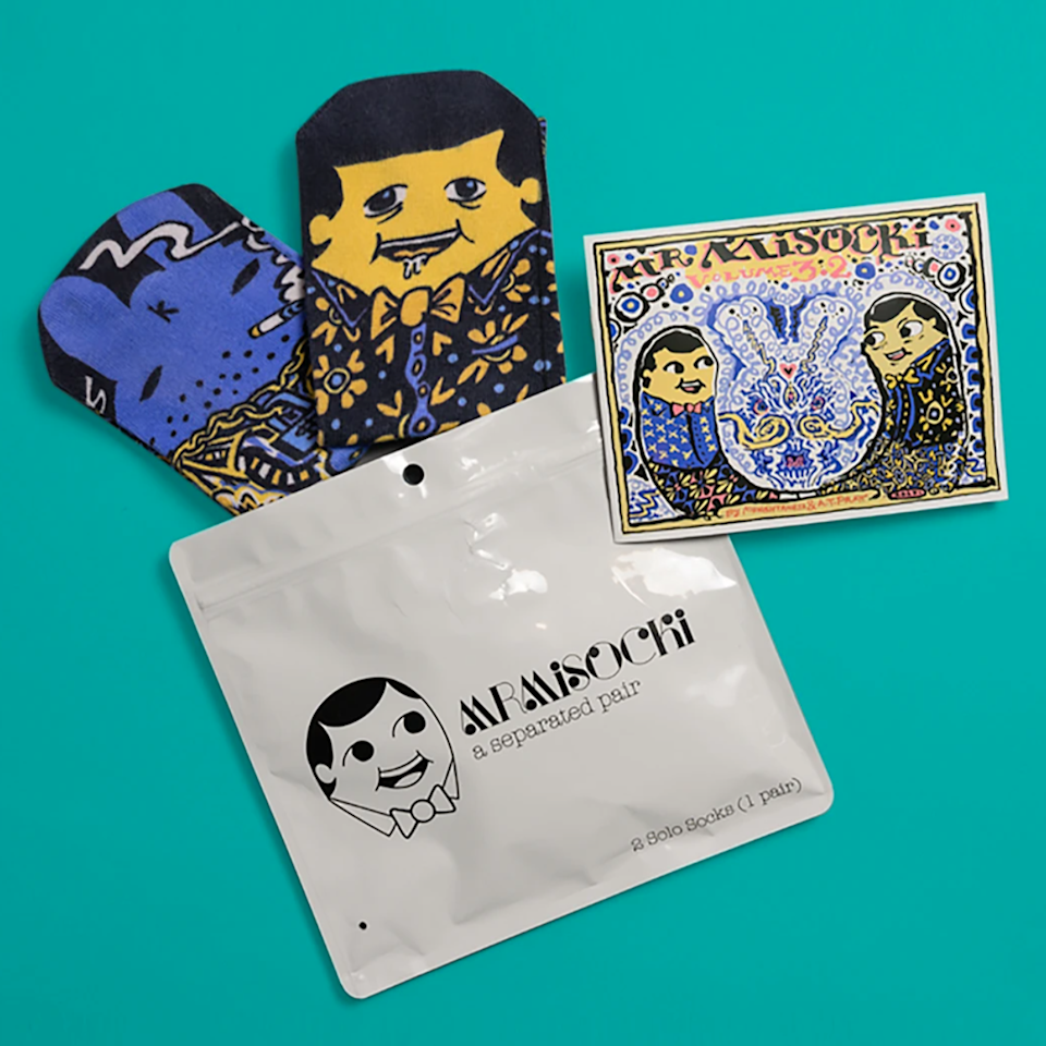 """<h2>Mr. MiSocki Pair of Socks + Comic Book</h2><br><strong>Best For: Dads/Brothers</strong><br><strong>Budget: $20</strong><br>This charmingly unusual gift from independent designer Munish Taneja comes with a fun pair of socks and a story. The comic book tells the tale of a sock that's developed a small addiction to soap and gambling. The """"volumes"""" are limited, shop this unique find for the guy you know will appreciate it before it's too late. <br><br><em>Shop <strong><a href=""""https://www.mrmisocki.com/"""" rel=""""nofollow noopener"""" target=""""_blank"""" data-ylk=""""slk:Mr. MiSocki"""" class=""""link rapid-noclick-resp"""">Mr. MiSocki</a></strong></em><br><br><strong>MrMiSocki x Kidrobot</strong> Volume 3.2 -Labbit & Socki, $, available at <a href=""""https://go.skimresources.com/?id=30283X879131&url=https%3A%2F%2Fwww.mrmisocki.com%2Fcollections%2Fvolumes%2Fproducts%2Fvolume-3-2%3Fsscid%3D31k5_8y3lr"""" rel=""""nofollow noopener"""" target=""""_blank"""" data-ylk=""""slk:MrMiSocki"""" class=""""link rapid-noclick-resp"""">MrMiSocki</a>"""
