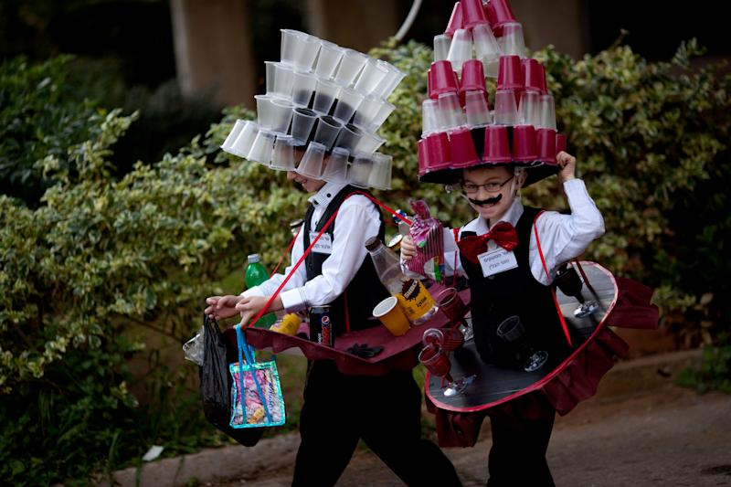 Moti and Elazar, 8, two Ultra Orthodox Jewish boys dressed in costumes walk during the Purim festival in the ultra-Orthodox town of Bnei Brak, Israel,Sunday, Feb. 24, 2013. (AP Photo/Ariel Schalit)