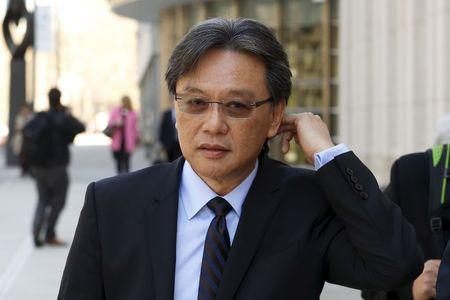 Eduardo Li exits the Brooklyn Federal Courthouse in New York