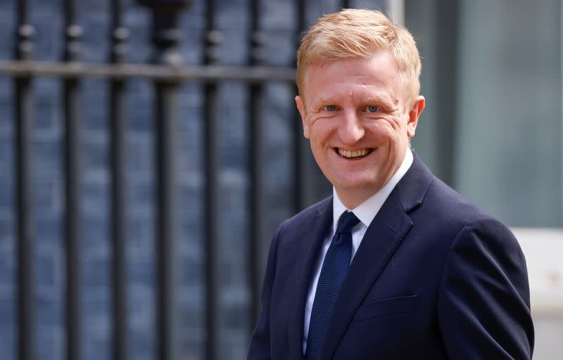 Britain's Secretary of State for Digital, Culture, Media and Sport Oliver Dowden walks outside Downing Street, in London