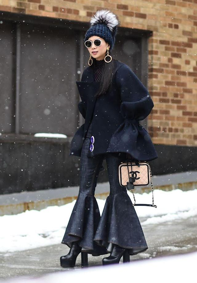 <p>If you love risks, embrace exaggerated details, from your coat all the way down to your hemline. Go for drama with high-heeled platform boots, a statement purse, earrings, and furry pom-pom hat. (Photo: Getty Images) </p>