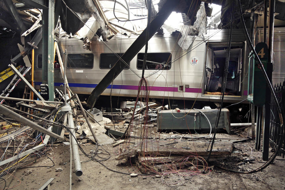 FILE – This Oct. 1, 2016, file photo provided by the National Transportation Safety Board shows damage from a Sept. 29, 2016, commuter train crash that killed a woman and injured more than 100 people at the Hoboken Terminal in Hoboken, N.J. NJ Transit has reached settlements in lawsuits filed by the family of a woman killed and people injured in a 2016 crash when a train slammed into the Hoboken station. NJ Transit spokesperson Nancy Snyder said settlements were reached in the lawsuits on Wednesday evening, May 12, 2021, NJ.com reported. (Chris O'Neil/National Transportation Safety Board via AP, File)