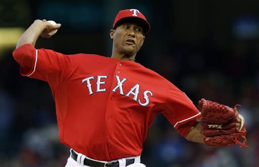 Texas Rangers starting pitcher Alexi Ogando (41) throws during the first inning of a baseball game against the Boston Red Sox on Saturday, May 4, 2013, in Arlington, Texas. (AP Photo/LM Otero)
