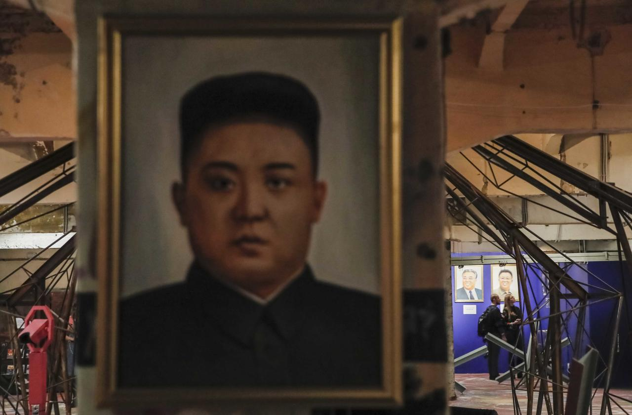 "Portraits of North Korean leaders Kim Jong Un, Kim Il-sung and Kim Jong-il are on display at the ""Made In North Korea"" exhibition held at the UMAM museum in Moscow, Russia January 20, 2018. REUTERS/Maxim Shemetov"