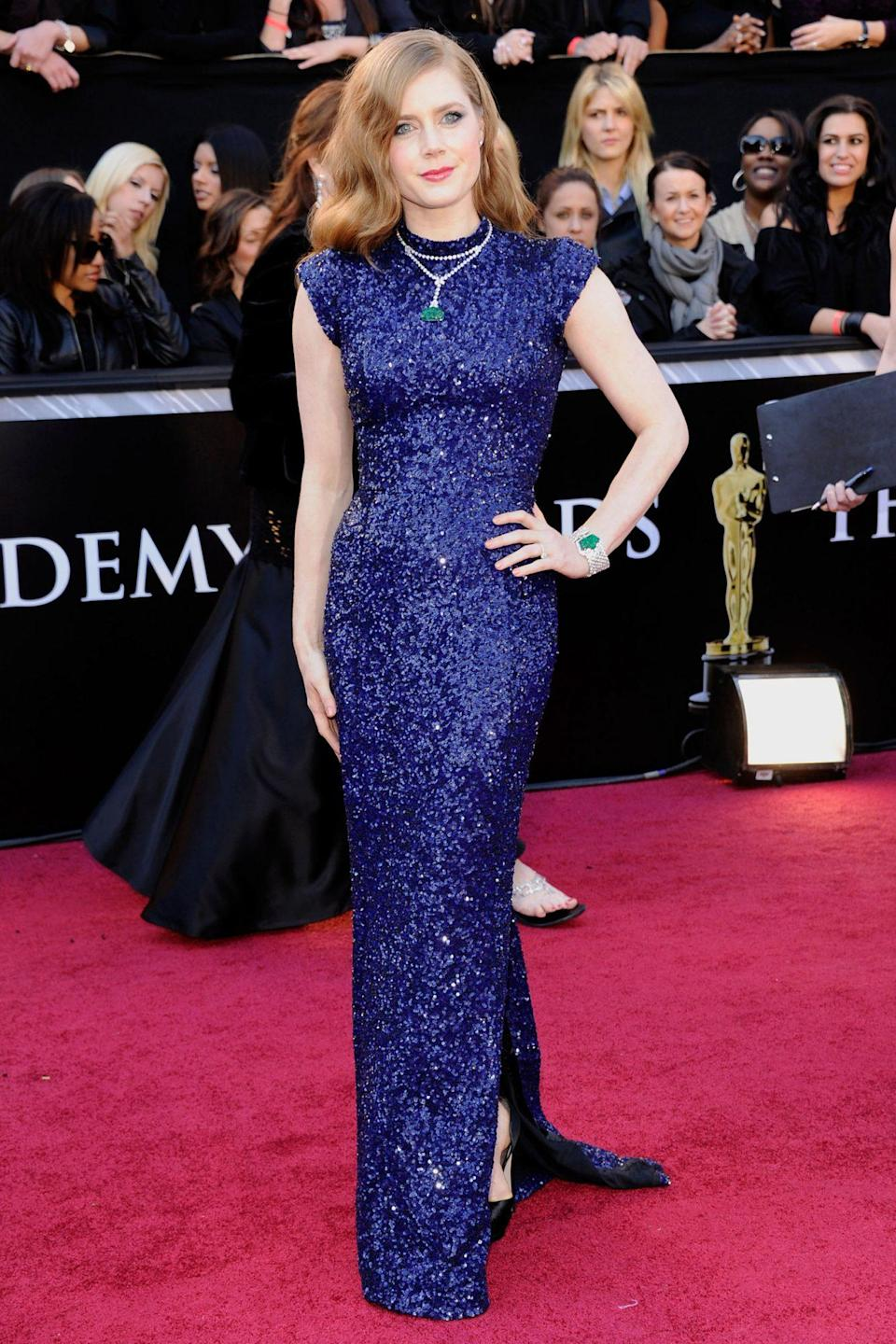 <p>Amy Adams shined on the carpet in a stunning navy blue L'Wren Scott gown. She was nominated for Best Supporting Actress for her role in <em>The Fighter. </em></p>