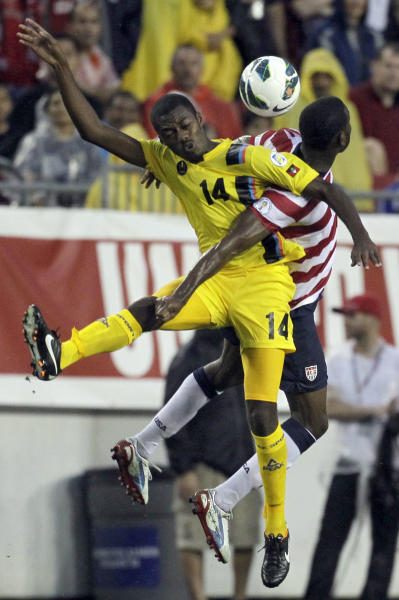 Antigua and Barbuda midfielder Randolph Burton (14) beats U.S. midfielder Maurice Edu to the ball during the first half of a FIFA World Cup qualifying soccer match Friday, June 8, 2012, in Tampa, Fla. (AP Photo/Chris O'Meara)