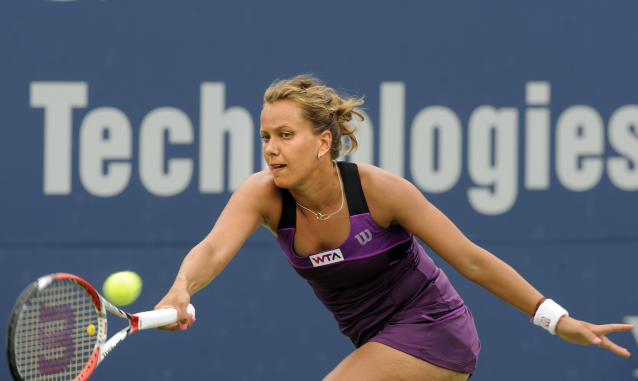 Barbora Zahlavova Strycova, of the Czech Republic, hits a forehand during a quarterfinal match against match against compatriot Petra Kvitova at the New Haven Open tennis tournament in New Haven, Conn., on Thursday, Aug. 21, 2014. (AP Photo/Fred Beckham)