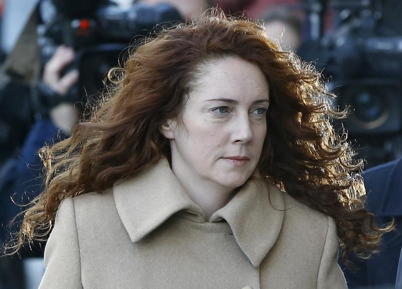 Rebekah Brooks arrives at The Old Bailey law court in London, Monday, Oct. 28, 2013. Former News of the World national newspaper editors Rebekah Brooks and Andy Coulson are due to go on trial Monday, along with several others, on charges of hacking phones and bribing officials while at the now closed tabloid paper.(AP Photo/Kirsty Wigglesworth)