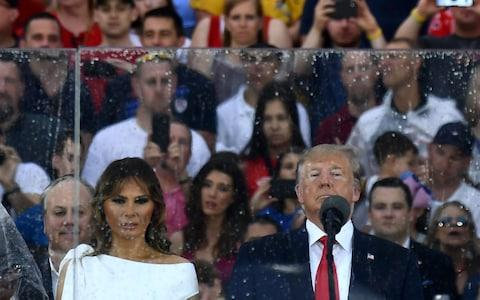 "First Lady Melania Trump and US President Donald Trump look on during the ""Salute to America"" Fourth of July event - Credit: AFP"