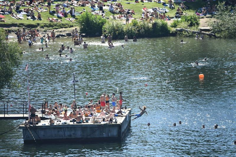 Sweden's residents enjoyed relative freedom during the first wave. A photo of people gathered at a busy swimming spot.