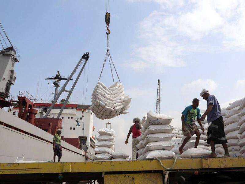 Workers unload wheat provided by UNICEF at the Red Sea port of Hodeidah in January (AFP/Getty)