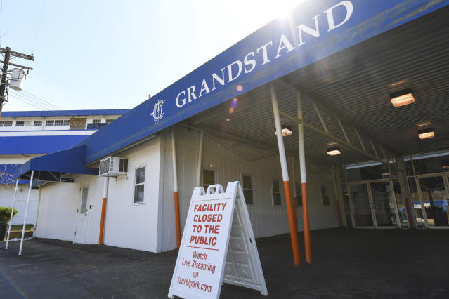 A closed to the public sign sits outside of the Grandstand at Laurel Park Race Track, Saturday, March 14, 2020, in Laurel, Md. The track is closed to the public due the coronavirus outbreak. (AP Photo/Terrance Williams)