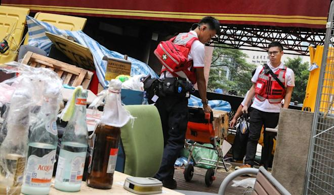 Two members of the Red Cross prepare to enter the Polytechnic University campus. Photo: K.Y. Cheng