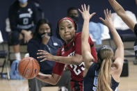 North Carolina State forward Kayla Jones (25) passes around North Carolina guard Stephanie Watts (5) during the first half of an NCAA college basketball game in Chapel Hill, N.C., Sunday, Feb. 7, 2021. (AP Photo/Gerry Broome)
