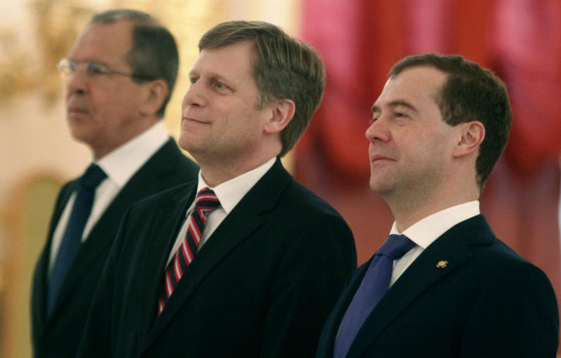 Russian Foreign Minister Sergey Lavrov, left, US Ambassador to Russia, Michael McFaul, center, and Russian President Dmitry Medvedev during a ceremony of receiving credentials in Moscow's Kremlin on Wednesday, Feb. 22, 2012. (AP Photo/Mikhail Metzel)