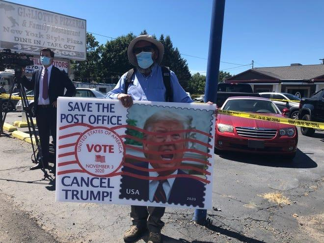 Gene Stilp of Dauphin County protests what he believes are efforts by the Trump administration to slow mail delivery, Aug. 20, 2020 in Old Forge, Pa.