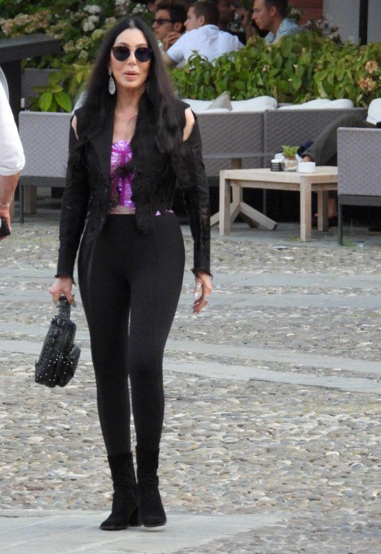 Cher is seen out for a walk with friends in Portofino, Italy, July 18. - Credit: Oliver Palombi/MEGA