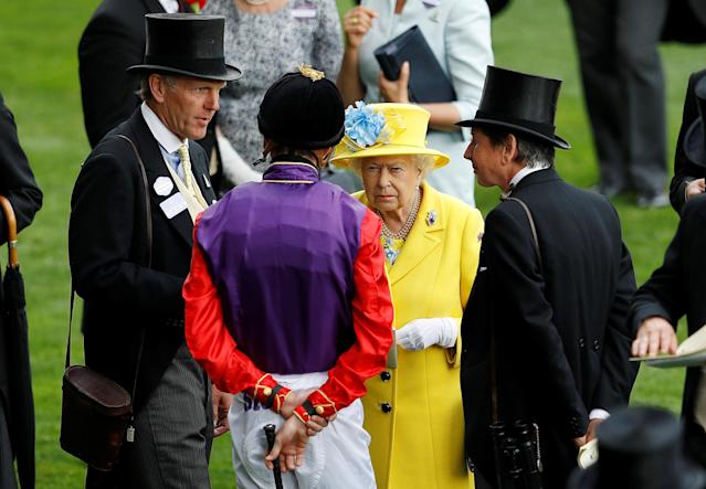 Horse Racing - Royal Ascot - Ascot Racecourse, Ascot, Britain - June 19, 2018 Britain's Queen Elizabeth speaks with a jockey during Royal Ascot REUTERS/Peter Nicholls