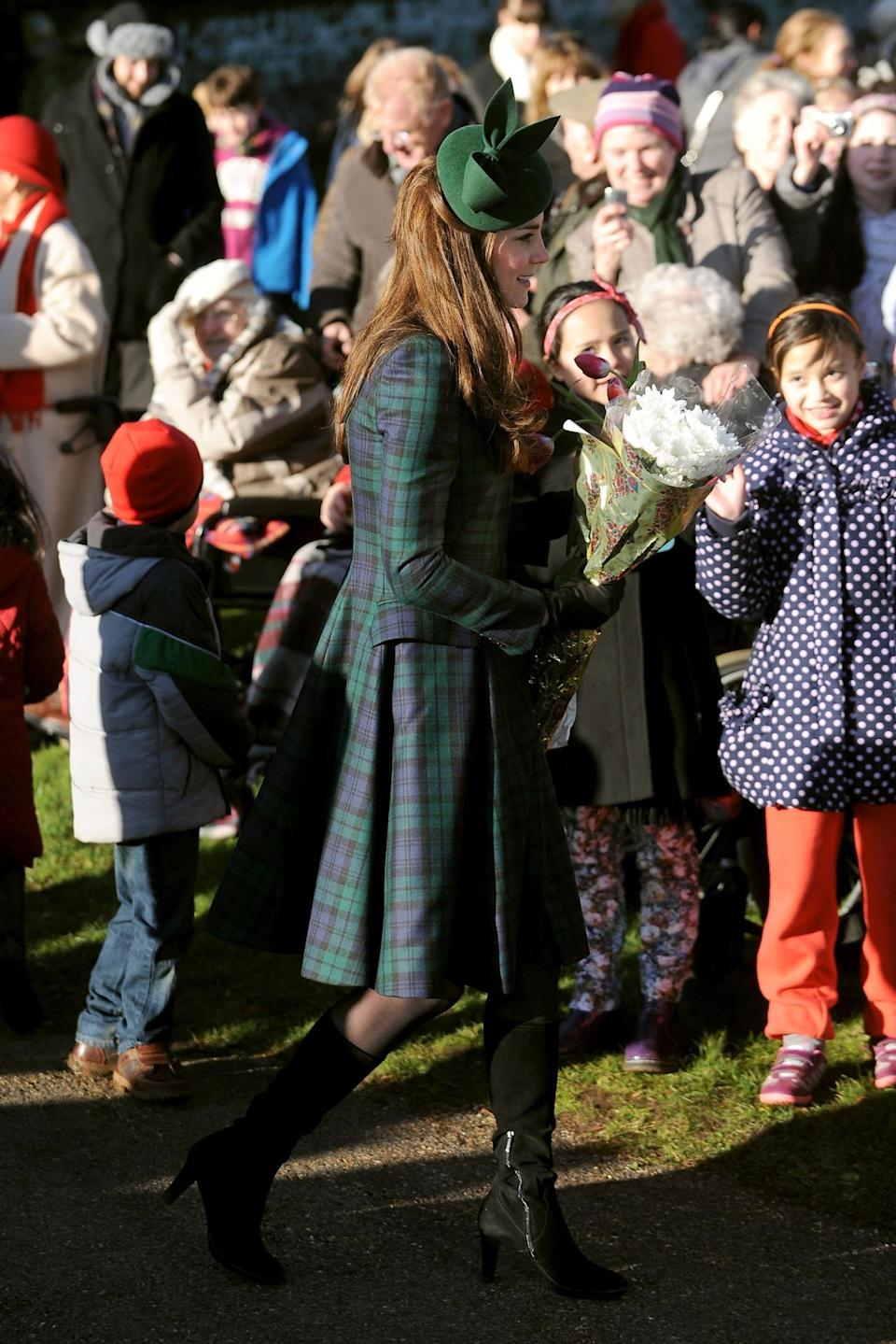 <p>For Christmas Day in Norfolk, Kate donned a tartan coat by Alexander McQueen's diffusion line, McQ. She also wore a dark green hat by Gina Foster and her trusty knee high Aquatalia boots.</p><p><i>[Photo: PA]</i></p>