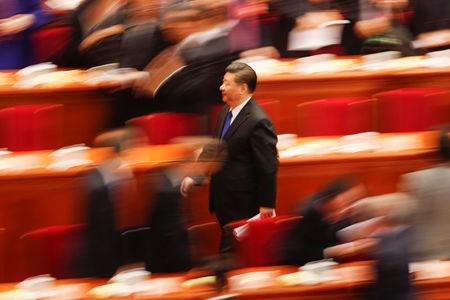 Chinese President Xi Jinping leaves after the opening session of the Chinese People's Political Consultative Conference (CPPCC) at the Great Hall of the People in Beijing