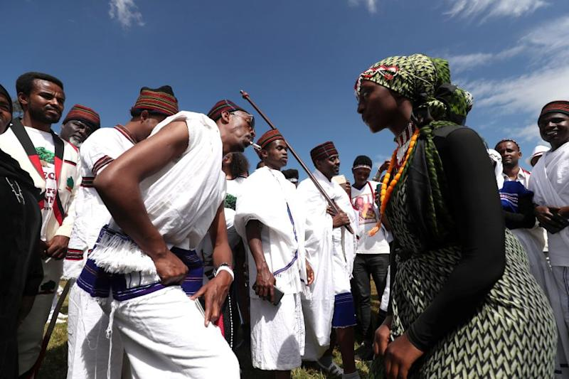 An Ethiopian couple dance as they take part in the Irreecha celebration, the Oromo People thanksgiving ceremony in Addis Ababa, Ethiopia. October 5, 2019.