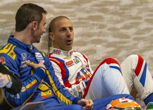 IndyCar driver Alexander Rossi, left, speaks with fellow driver Tony Kanaan between interviews during IndyCar auto racing media day, Monday, Feb. 11, 2019, in Austin, Texas. (AP Photo/Stephen Spillman)