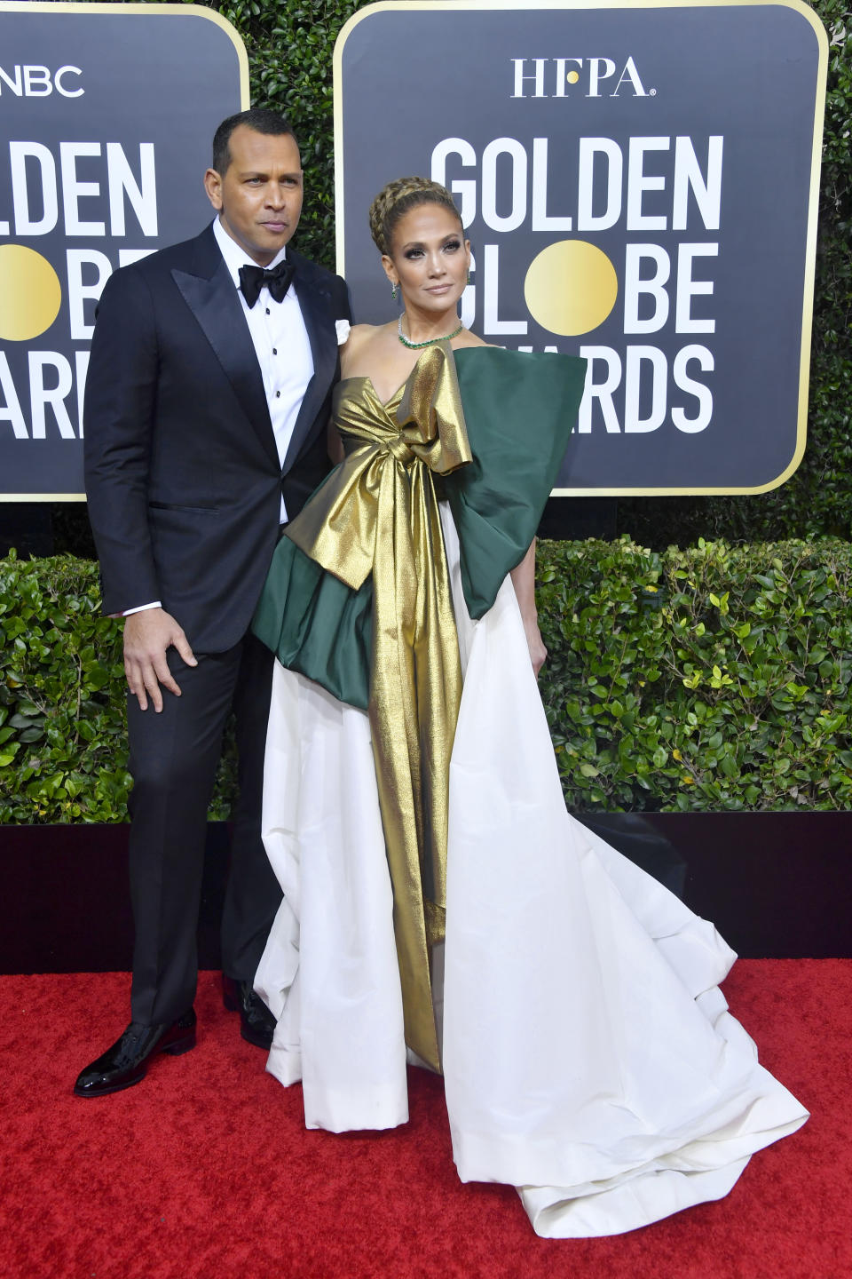 """Nominated for her role in """"Hustlers,"""" Jennifer Lopez gifted the red carpet with a bold look by Valentino. (Photo by Frazer Harrison/Getty Images)"""
