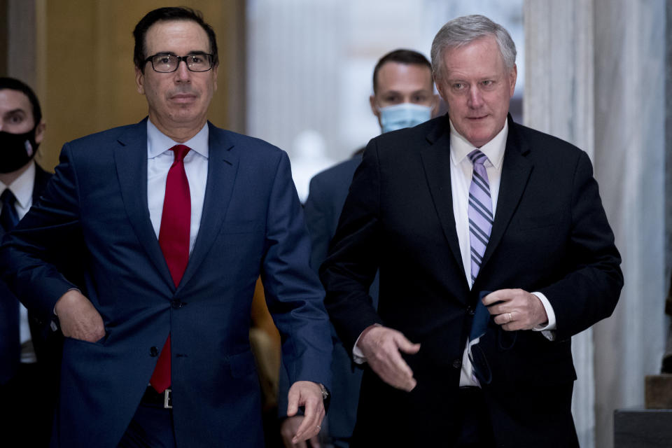 Treasury Secretary Steven Mnuchin, left, and White House Chief of Staff Mark Meadows, right, walk out of a meeting with House Speaker Nancy Pelosi of Calif. and Senate Minority Leader Sen. Chuck Schumer of N.Y. as they continue to negotiate a coronavirus relief package on Capitol Hill in Washington, Friday, Aug. 7, 2020. (AP Photo/Andrew Harnik)