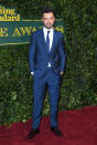 <p>Dominic opted for a petrol blue suit. <i>[Photo: Getty]</i> </p>