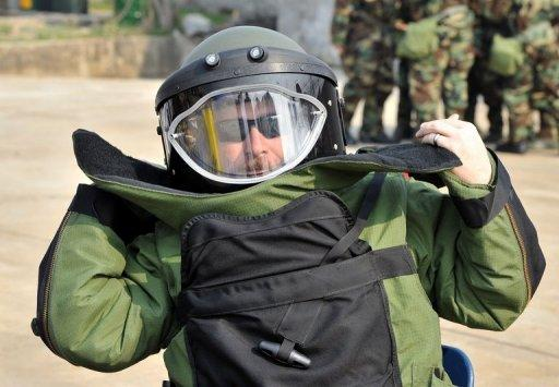 A US soldier wears a protective suit during an exercise at Camp Stanley in Uijeongbu, South Korea on April 4, 2013
