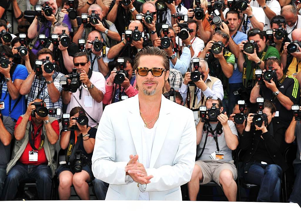 "His new film, ""The Tree Of Life,"" was apparently booed during one press screening in Cannes, but the star of movie, Brad Pitt, got plenty of cheers -- and attention from photographers -- on the red carpet at the film festival. Brad's wife, Angelina Jolie, was also in Cannes promoting her movie ""Kung Fu Panda 2."" Pascal Le Segretain/<a href=""http://www.gettyimages.com/"" target=""new"">GettyImages.com</a> - May 16, 2011"